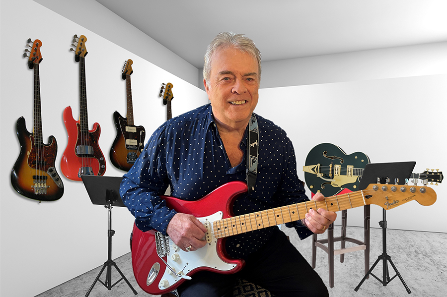 Tony Clout with Strat in white studio